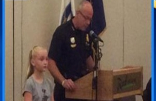 Girl honored for protecting her sister